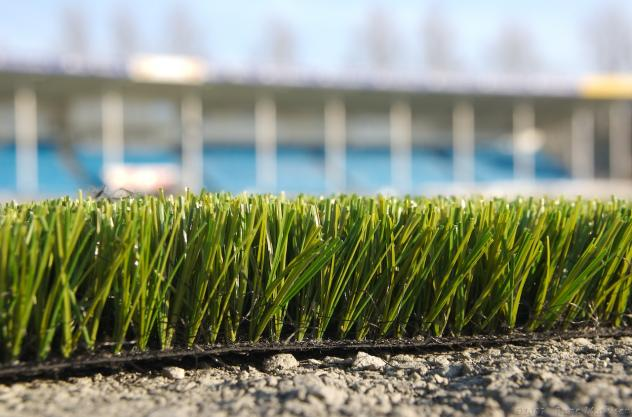 """Skagerak Arena turf"" by Rune Mathisen from Skien, Norway - Nytt kunstgressUploaded by Arsenikk. Licensed under CC BY-SA 2.0 via Wikimedia Commons"